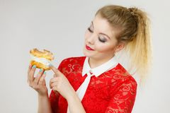 Happy woman holding choux puff cake Stock Images