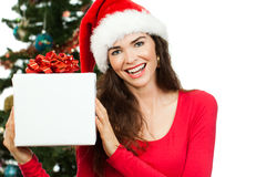 Happy woman holding Christmas gift Royalty Free Stock Image