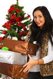 Happy woman holding Christmas gifts Royalty Free Stock Photography