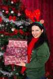 Happy woman holding Christmas gifts Royalty Free Stock Photos