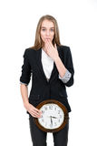 Happy woman holding clock Royalty Free Stock Images