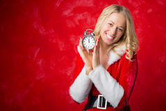 Happy woman holding a clock Stock Photos