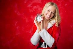 Happy woman holding a clock Stock Photos