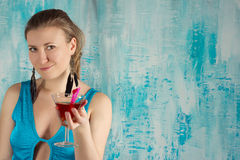 Happy  woman holding a cocktail Royalty Free Stock Photos