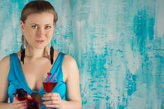 Happy  woman holding a cocktail Stock Photography