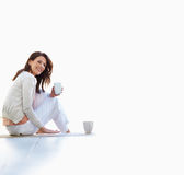 Happy woman holding coffee cup with copyspace Stock Image