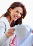 Happy woman holding coffee cup over white Royalty Free Stock Photos