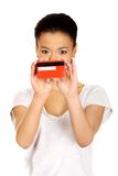 Happy woman holding a credit card. Stock Images