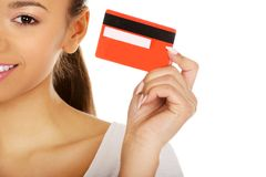 Happy woman holding a credit card. Royalty Free Stock Photo
