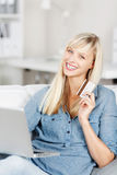 Happy woman holding a credit card and laptop Stock Image