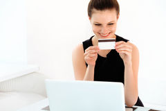 Happy Woman Holding a Credit Card and Shopping From the Internet Royalty Free Stock Photo