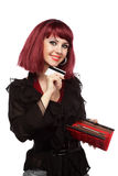 Happy woman holding credit card and wallet Stock Photography