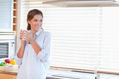 Happy woman holding a cup of coffee Royalty Free Stock Photography