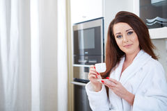 Happy woman holding a cup of coffee Royalty Free Stock Photo
