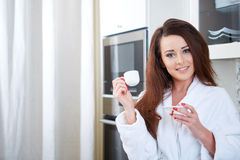 Happy woman holding a cup of coffee Stock Photos