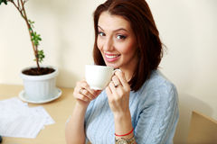 Happy woman holding cup with coffee Royalty Free Stock Image