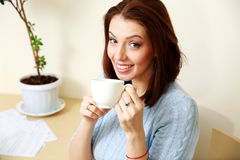 Happy woman holding cup with coffee Royalty Free Stock Photography