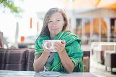 Happy Woman holding a cup of coffee Stock Photo