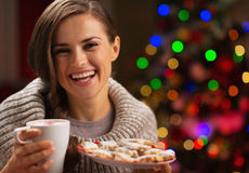 Happy woman holding cup of hot chocolate Stock Photos