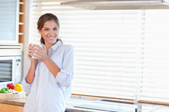 Happy woman holding a cup of tea Stock Photography