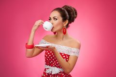 Happy Woman Holding Cup of Tea and Drinking. Pin Stock Photography