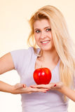 Happy woman holding delicious red apple Stock Image