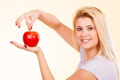 Happy woman holding delicious red apple Stock Photo