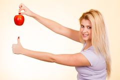 Happy woman holding delicious red apple Royalty Free Stock Photos