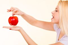 Happy woman holding delicious red apple Stock Images
