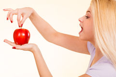 Happy woman holding delicious red apple Royalty Free Stock Photography