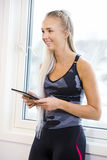 Happy Woman Holding Digital Tablet In Gym Stock Photo