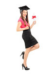 Happy woman holding a diploma Royalty Free Stock Photo