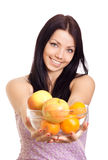 Happy woman holding a dish with fruits Royalty Free Stock Image