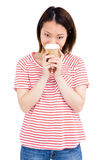 Happy woman holding disposable coffee cup Stock Photography