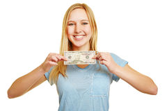 Happy woman holding 50 dollar bill. In her hands Royalty Free Stock Images