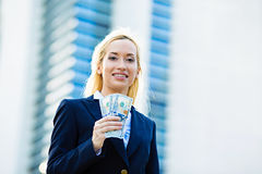 Happy woman holding dollar bills Royalty Free Stock Images