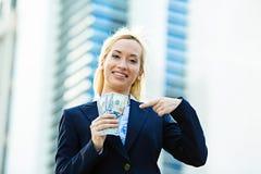Happy woman holding dollar bills Stock Photography