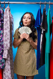 Happy Woman Holding Dollars At The Clothing Rack With Dresses Royalty Free Stock Photos