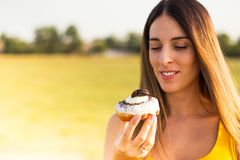 Happy woman holding donuts stock photos