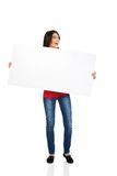 Happy woman holding empty banner. Royalty Free Stock Images