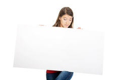 Happy woman holding empty banner. Royalty Free Stock Photography