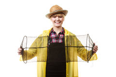 Happy woman holding empty fishing keepnet Royalty Free Stock Photo