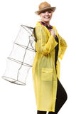 Happy woman holding empty fishing keepnet. Spinning, angling, cheerful fisherwoman concept. Happy woman in yellow raincoat holding empty fishing keepnet, having stock photo