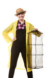 Happy woman holding empty fishing keepnet. Spinning, angling, cheerful fisherwoman concept. Happy woman in yellow raincoat holding empty fishing keepnet, having stock photos