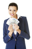 Happy woman holding euro money Royalty Free Stock Image