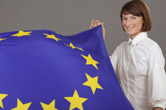 Happy woman holding european flag Royalty Free Stock Photos