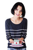 Happy woman holding euros bills and house model Royalty Free Stock Images