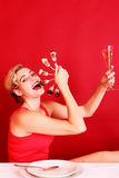 Happy Woman Holding a Fan of Fork and Wine Glass Stock Photos