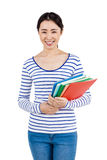 Happy woman holding files. Portrait of a happy woman holding files against white background Stock Photo