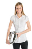 Happy Woman Holding Film Slate And Reel Stock Photography